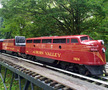 """The F-7 Double Unit is a diesel train that is red and has the words """"Auburn Valley"""" painted on the side in yellow letters"""