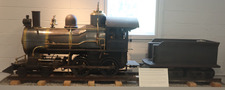 The 1905 Cagney Model D Locomotive is a large black train with gold detailing
