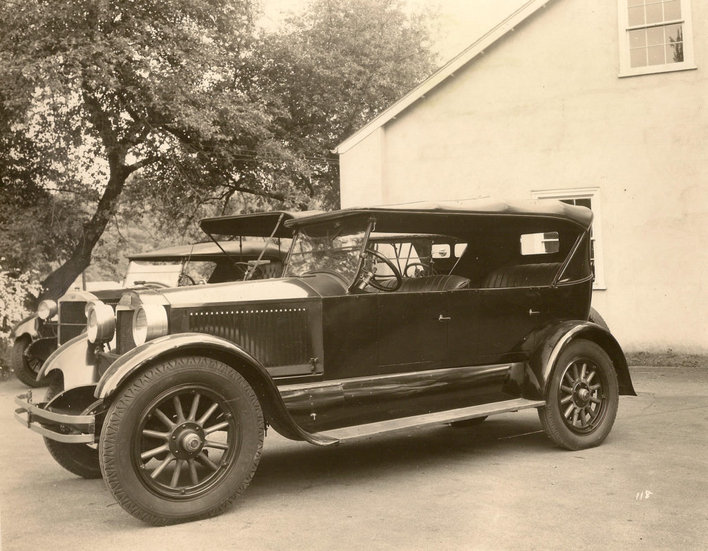 The 1924 Stanley Model 750 is an all black car, and the side of it is shown in this black and white photo