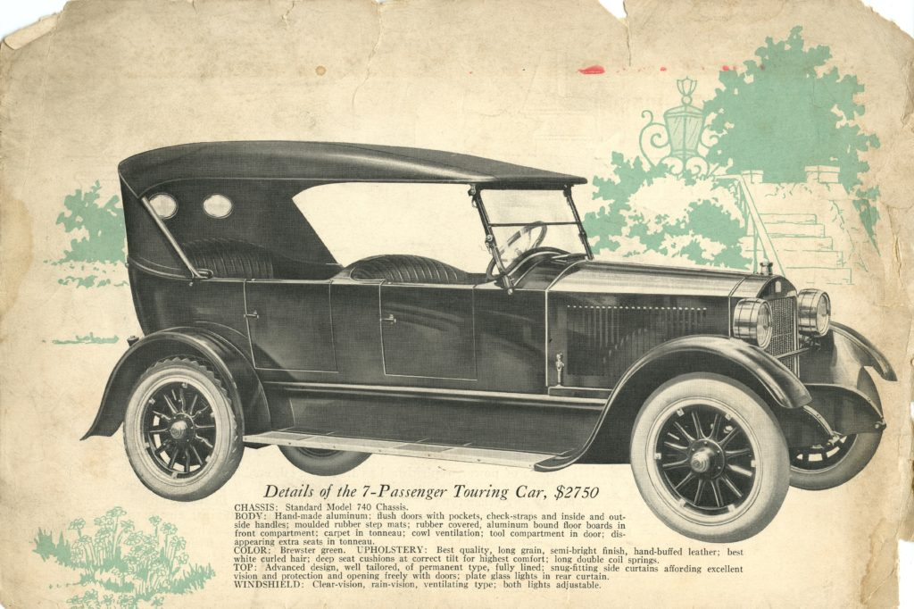 An ad for the 1922 Stanley Model 740, it features a side profile ofht ecar and there are green leaves drawn behind the car