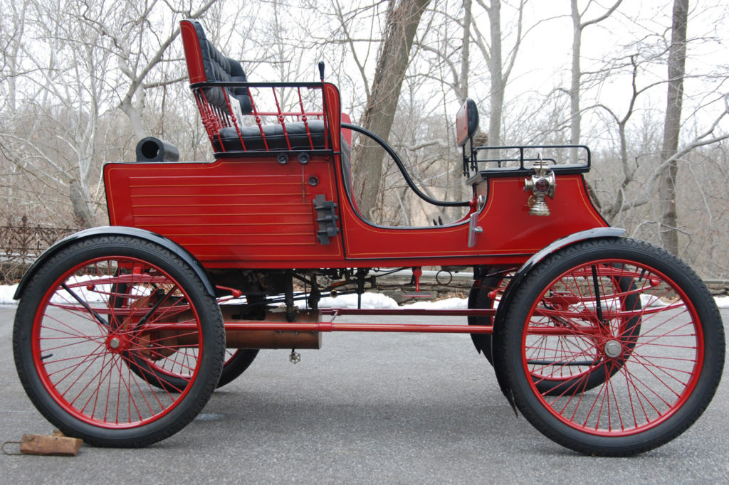The 1902 Stanley Stick-Seat Runabout is an all red car, with black seats and black tires. It is carriage shaped, and the drivers seat is behind the passengers