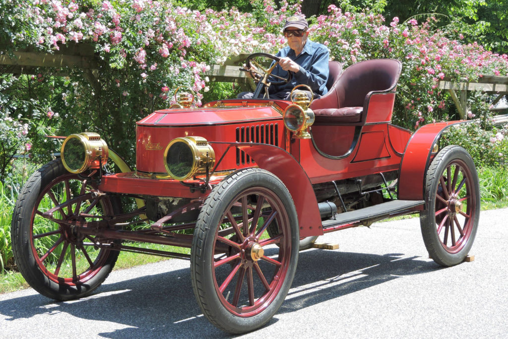 The 1908 Stanley Gentleman's Speedy Roadster H-5 is a fully red car with gold accents, it looks like a cross between a car and a carriage