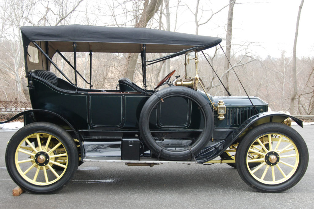 The 1913 Stanley Model 76 has a black top, with a blue body, and yellow wheels and undercarriage