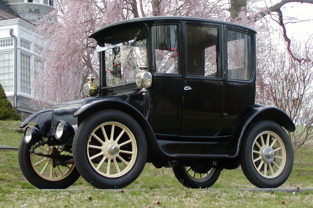 The 1916 Rauch and Lang Electric car is an all black vehicle with yellow wheel spokes