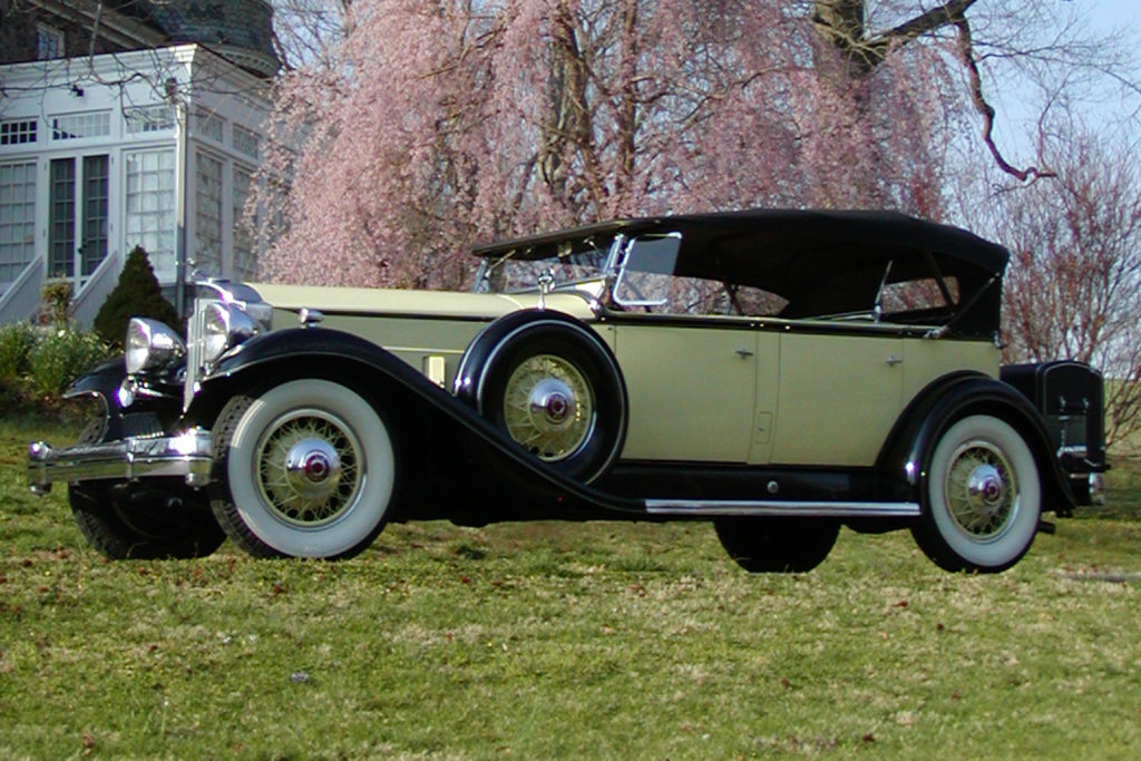 The 1932 Packard Model 905 is a yellow car with black detailing
