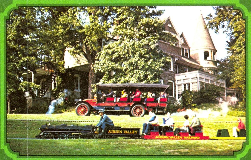 The Auburn Valley railroad is shown riding in front of the Mountain Wagon, both have fully loaded cars