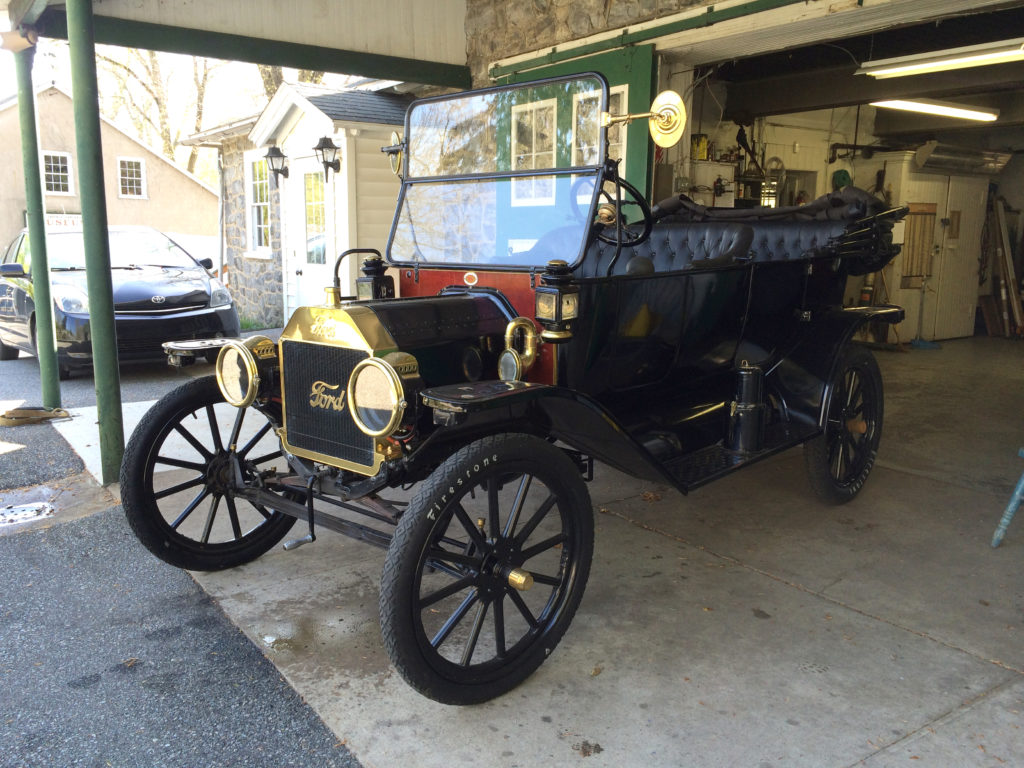 The model T is parked in front of the Marshall Steam Museum's garage