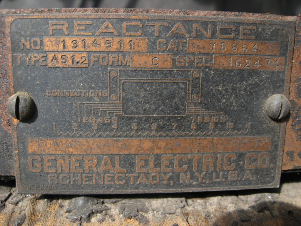 """A metal label that has electrical diagrams on it, in large text it reads """"General Electric Co. Schenectady, N.Y., U.S.A."""