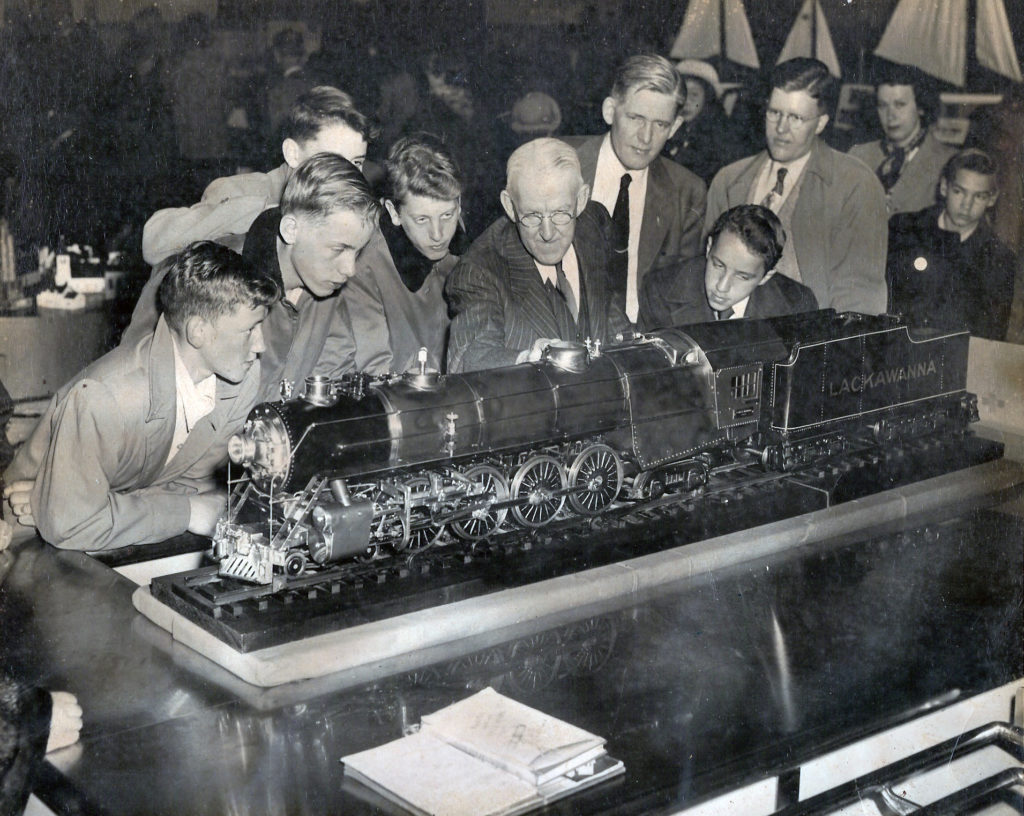 Several men are standing behind the 4-8-4 Pocono (Northern) Lackawanna, one of whom is Clarence Marshall